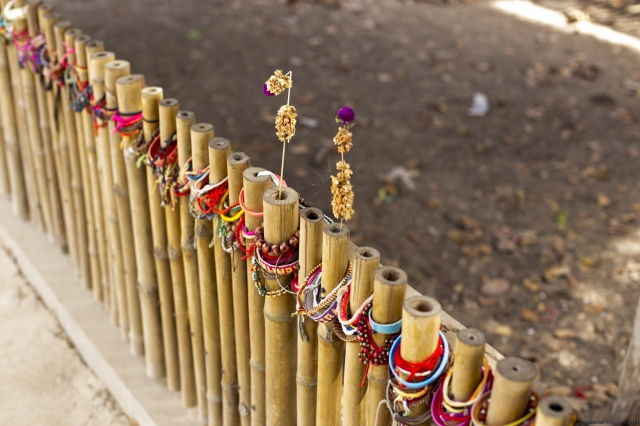 A fence around a mass grave at the Killing Fields