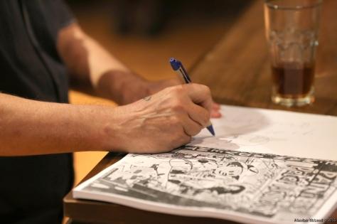 Klashorst signs a copy of the catalogue